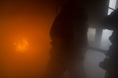 Firefighter getting ready to put out a fire