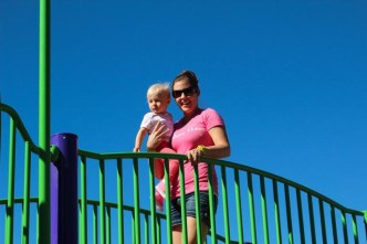 Jocelyn walking the bridge to the slide