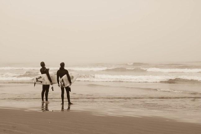 Surfers at Morro Bay Beach