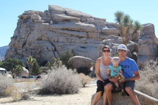 family shot... in front of rocks.