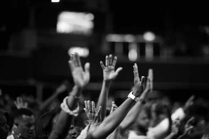 Hands reaching to heaven in prayer