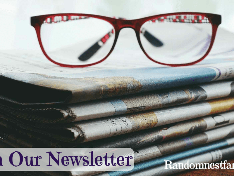 Glasses on top of newspaper_join Randomnesfamily.org newsletter