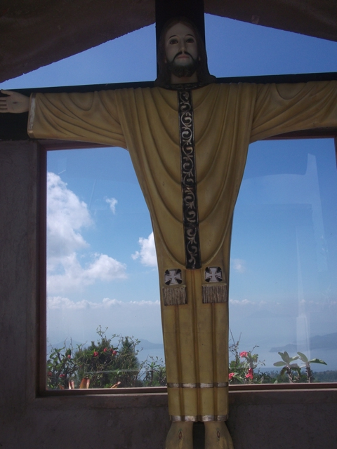 This one is located at the roof top and behind him is the magical view of the Taal Lake.
