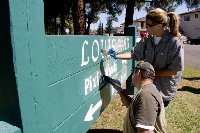 Painting the Louis Park sign