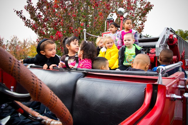 Children on a classic firetruck