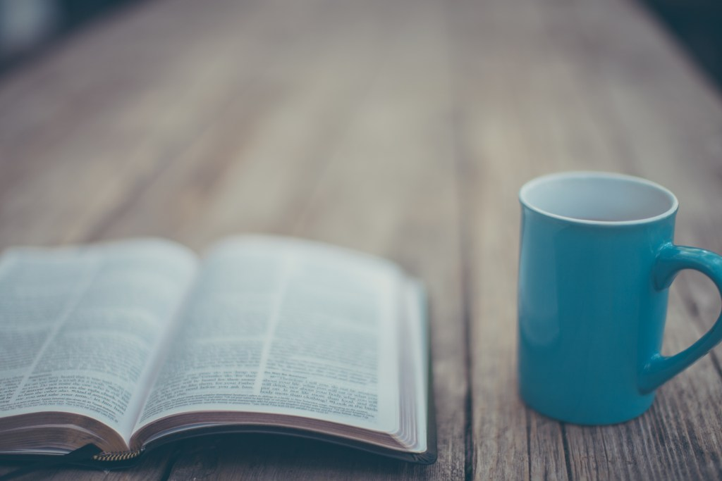 Bible and a blue cup