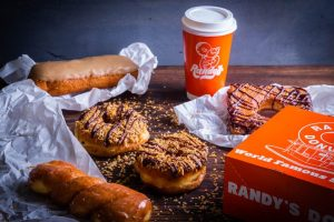 Selection of a variety of Randy's premium donuts and Randy's coffee