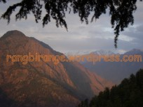 Himalayan peaks take on orange hue at sun down