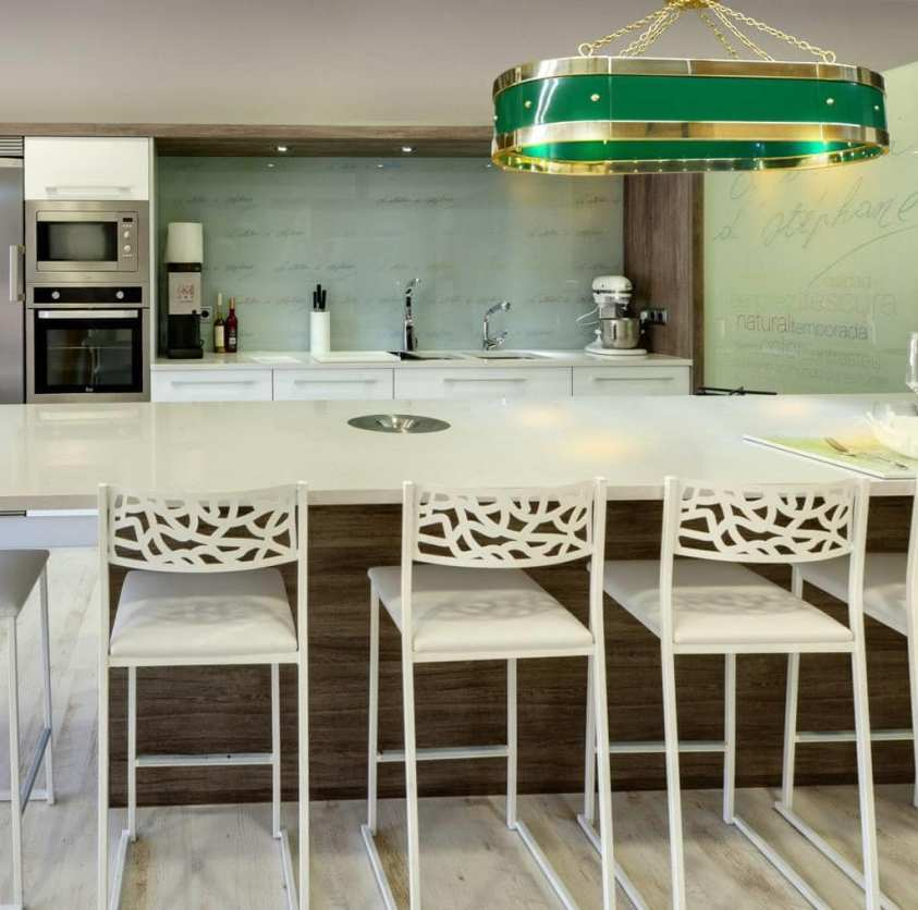 luxury kitchen with green range hood