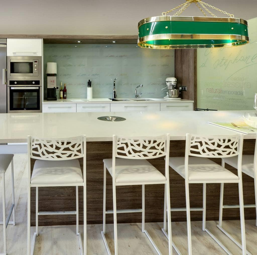 luxury kitchen with green range hood