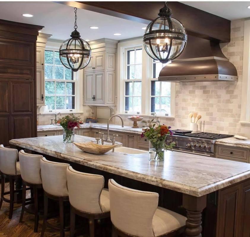 luxury kitchen with a range hood