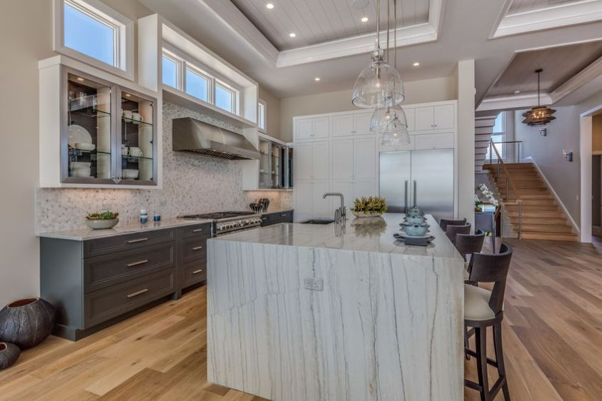 beautiful kitchen with a range hood and fan