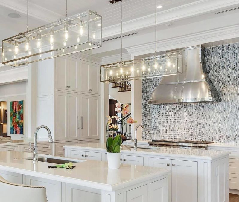 beautiful kitchen with stainless steel hood
