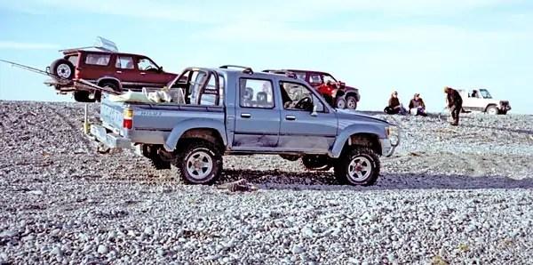 Ricoh 500G - Rakaia River Mouth whitebaiter's 4x4 trucks.