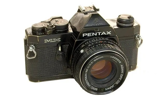 Well worn black Pentax MX with 50mm SMC Pentax-M lens.