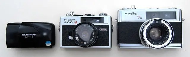 Size comparison between Olympus Mju II, Ricoh 500G, and Minolta 7S.