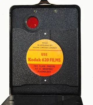 The label on the Inside of the film door says to use 620 film on the Kodak Flash II. The best option is to rewind the film from a 120 spool onto a 620 spool.