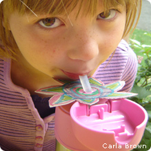 Girl with himmingbird sipper