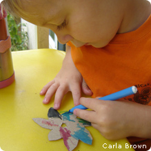Boy coloring flower