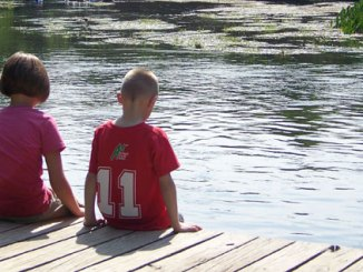 Children sitting on dock