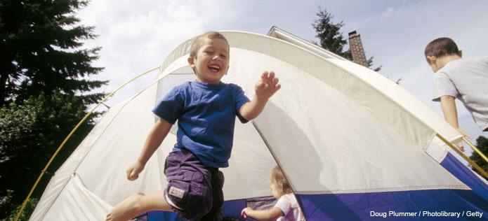 boy running tent