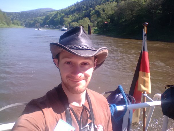 European Ranger Congress 2017 field trip. Tom on a police patrol boat on the River Elbe, in Bohemian Switzerland. This boat is used by both German and Czech police forces, and the German flag can be seen in the background.