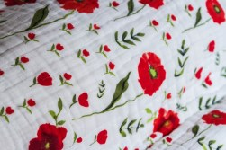Summery poppy flower baby blanket that I ordered from a small shop called Little Unicorn.