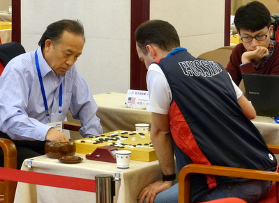 Huiren Yang (left) playing Alexandr Dinershteyn