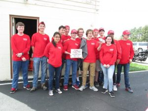 SuperMileage team holding First Place plaque.
