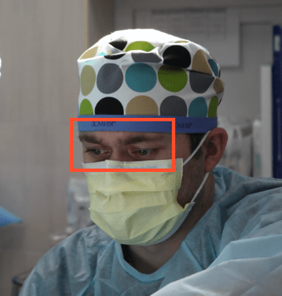 Image showing face detection for a subject wearing a mask and a medical cap.