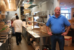 Dairy Bar owner Steve Brewer stands in his new kitchen, five days before his restaurant will reopen after a July 2014 fire.