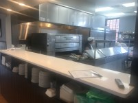 Diners can now see into an open kitchen.