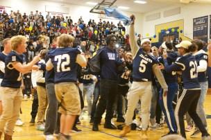 Evans' teammates surround him as he announces his decision via t-shirt reveal. Courtesy Lee County Schools.