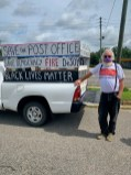 Activist David Freeman of Pittsboro poses with his truck