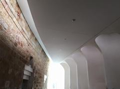 The hall outside the entrance to the courtrooms, juxtaposing old and new.