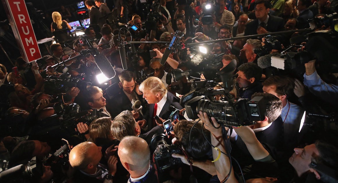 Donald Trump surrounded by news cameras (Getty Images)