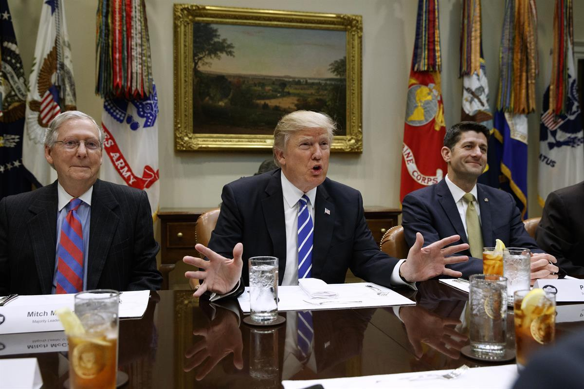 <strong>President Donald Trump,</strong> <strong>Senate Majority Leader Mitch McConnell (R-KY) </strong>(left), and<strong> House Speaker Paul Ryan (R-WI) </strong>(right) (AP/EvanVucci)