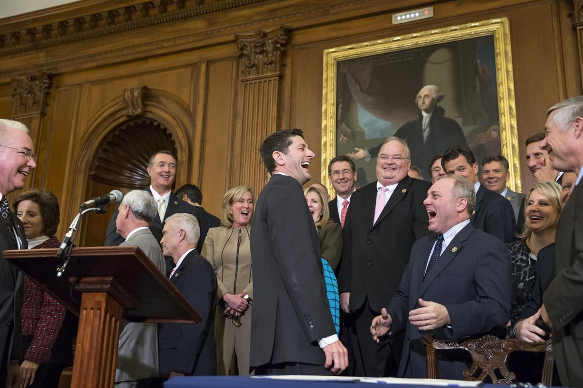 <strong>Speaker of the House Paul Ryan (R-WI)</strong>., left, laughs with <strong>Majority Whip Steve Scalise (R-LA)</strong>, center right, just after Ryan signed a bill designed to eliminate key parts Obamacare. Thursday, Jan. 7, 2016. (AP Photo/J. Scott Applewhite)