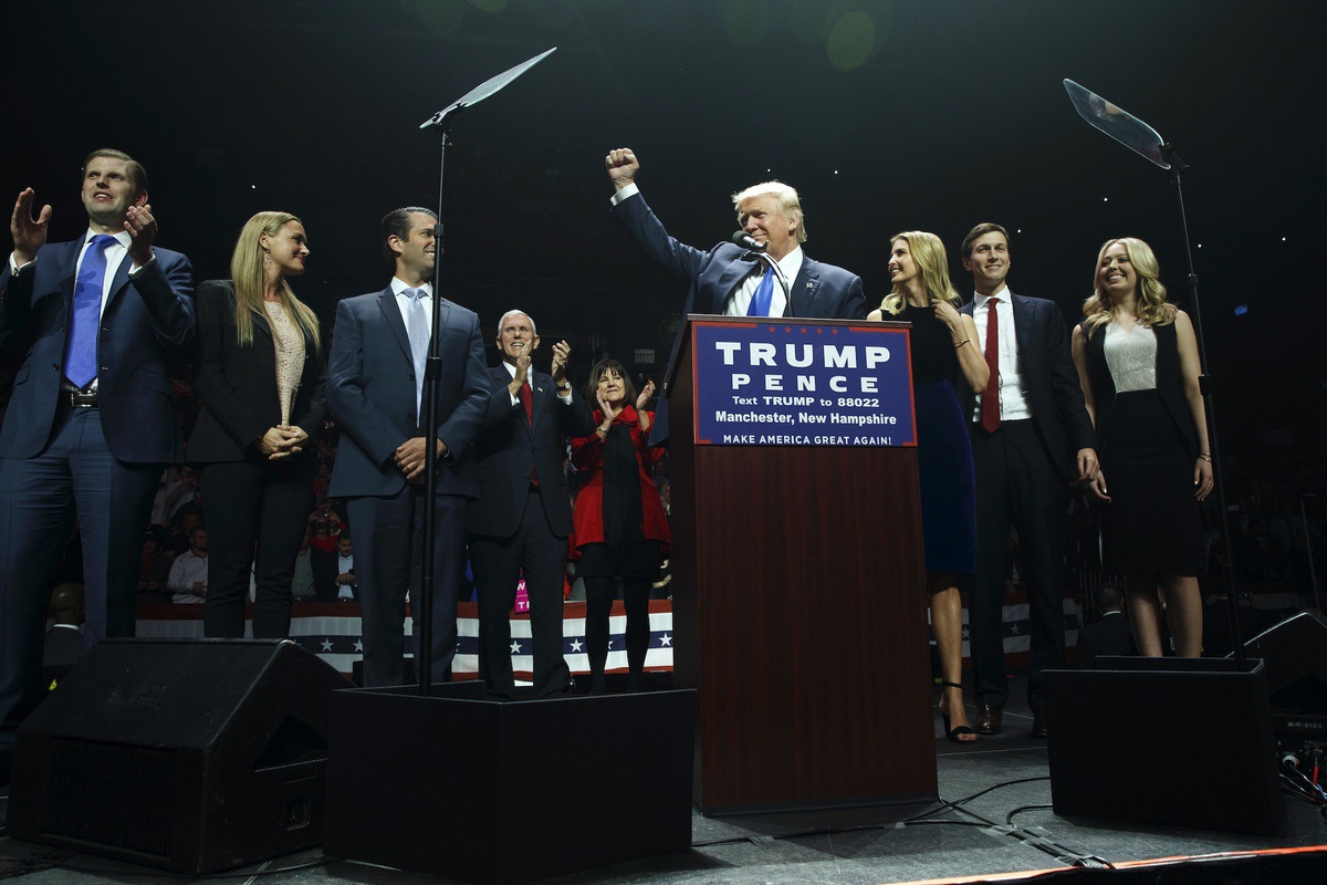 Donald Trump pumps his fist as he arrives to speak during a campaign rally, Monday, Nov. 7, 2016, in Manchester, N.H. From left, Eric Trump, Vanessa Trump, Donald Trump Jr., Mike Pence, R-Ind., Karen Pence, Trump, Ivanka Trump, Jared Kushner, and Tiffany Trump. (AP Photo/ Evan Vucci)