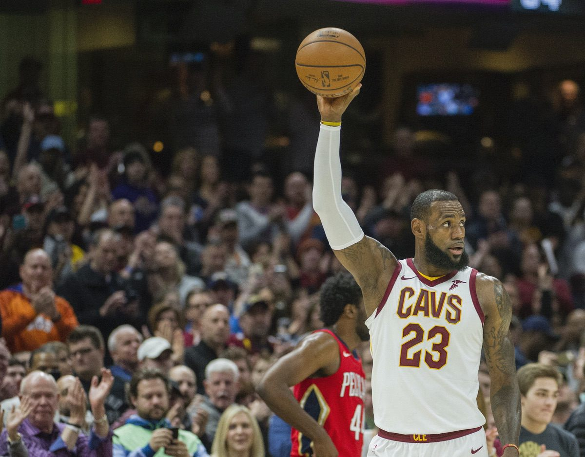 Cleveland Cavaliers' LeBron James celebrates his 867th game scoring in double figures, during the first half of an NBA basketball game against the New Orleans Pelicans in Cleveland, Friday, March 30, 2018. James passed Michael Jordan's mark of 866. (AP Photo/Phil Long)