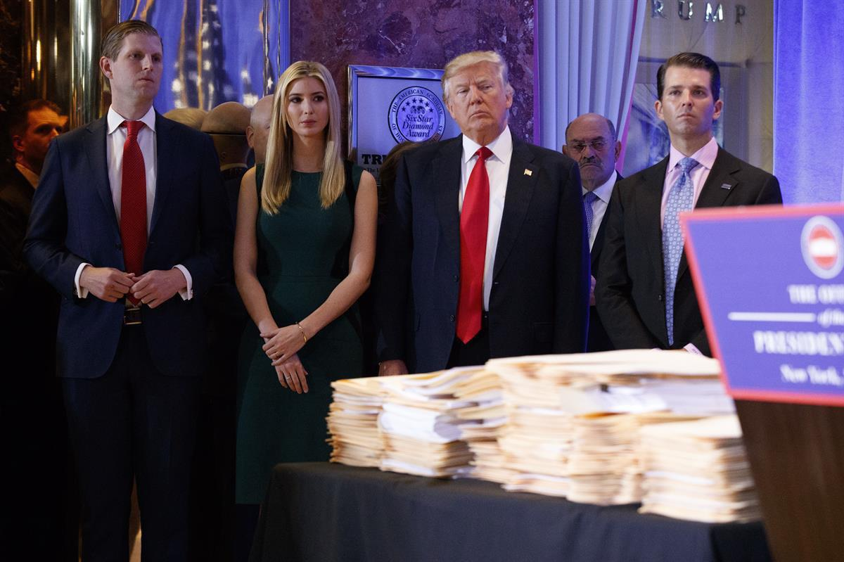 Donald Trump, accompanied by his family, at a news conference in the lobby of Trump Tower in New York Wednesday, Jan. 11, 2017. (AP Photo/Evan Vucci)