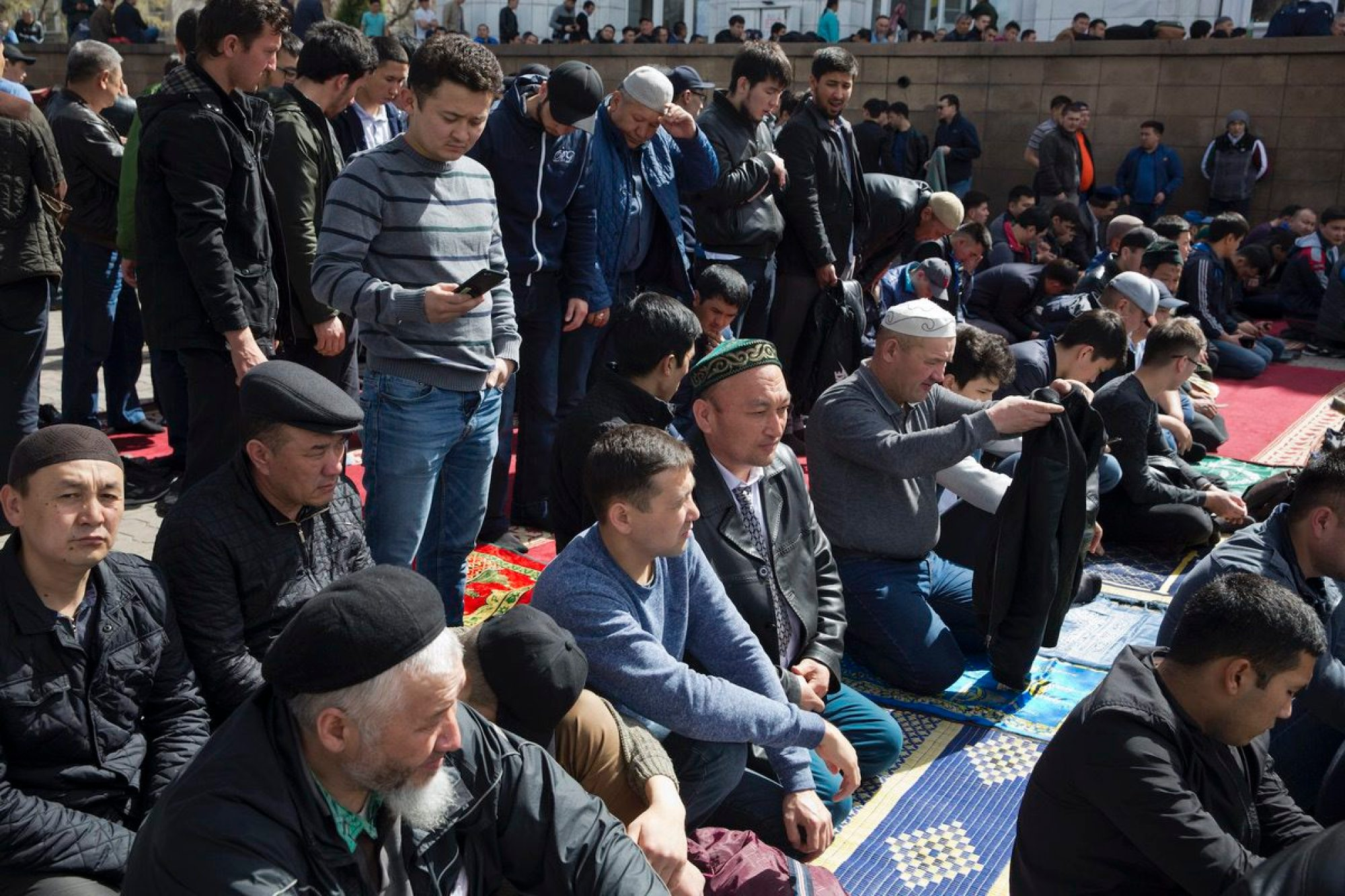 In this photo taken Friday, March 30, 2018, Omir Bekalic, center prepares to pray at a mosque in Almaty, Kazakhstan. Since 2016, Chinese authorities in the heavily Muslim region of Xinjiang have carried out a campaign of mass detentions and indoctrination in internment camps with the stated aim of bolstering national security and eliminating Islamic extremism. The program appears to be an attempt to rewire its detainees' political thinking, erase their Islamic beliefs and reshape their very identities. (AP Photo/Ng Han Guan)