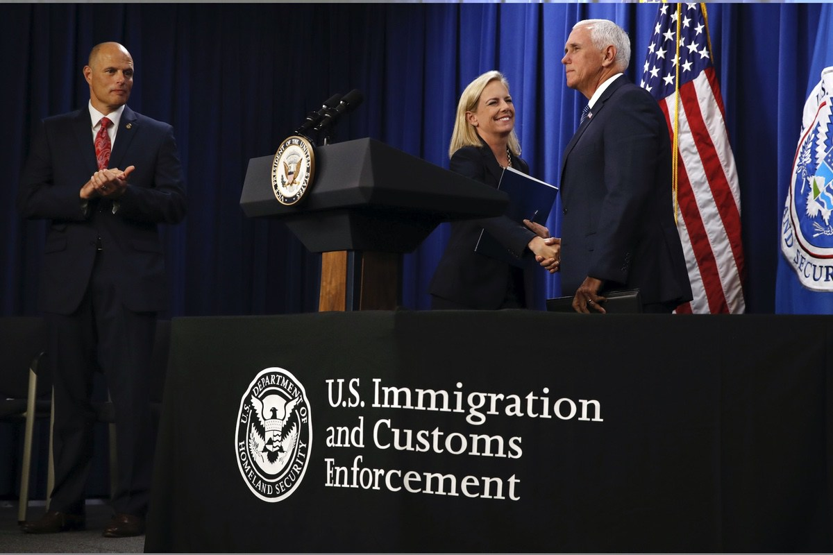 Vice President Mike Pence, right, shakes hands with Homeland Security Secretary Kirstjen Nielsen, next to Acting Director of U.S. Immigration and Customs Enforcement (ICE) Ronald Vitiello, as Pence arrives to speak at ICE headquarters, Friday, July 6, 2018, in Washington. (AP Photo/Jacquelyn Martin)
