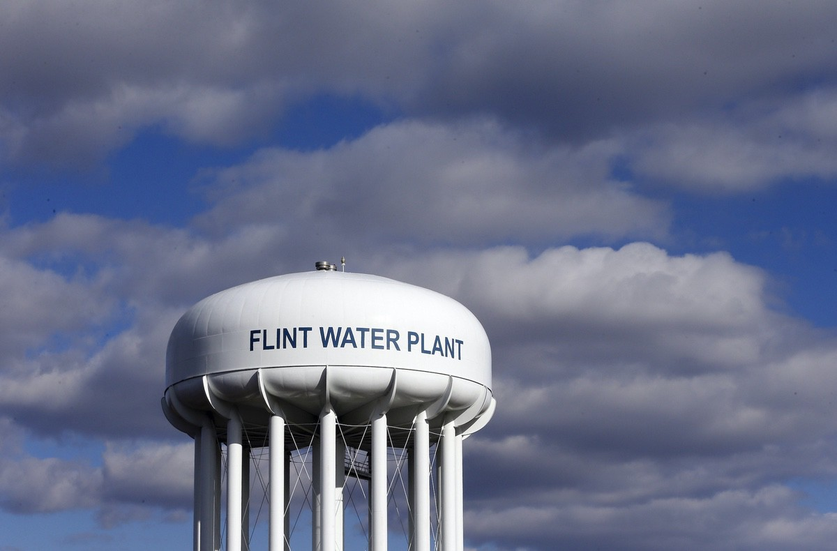 The Flint Water Plant water tower is seen in Flint, Mich. March 21, 2016 (AP Photo/Carlos Osorio, File)