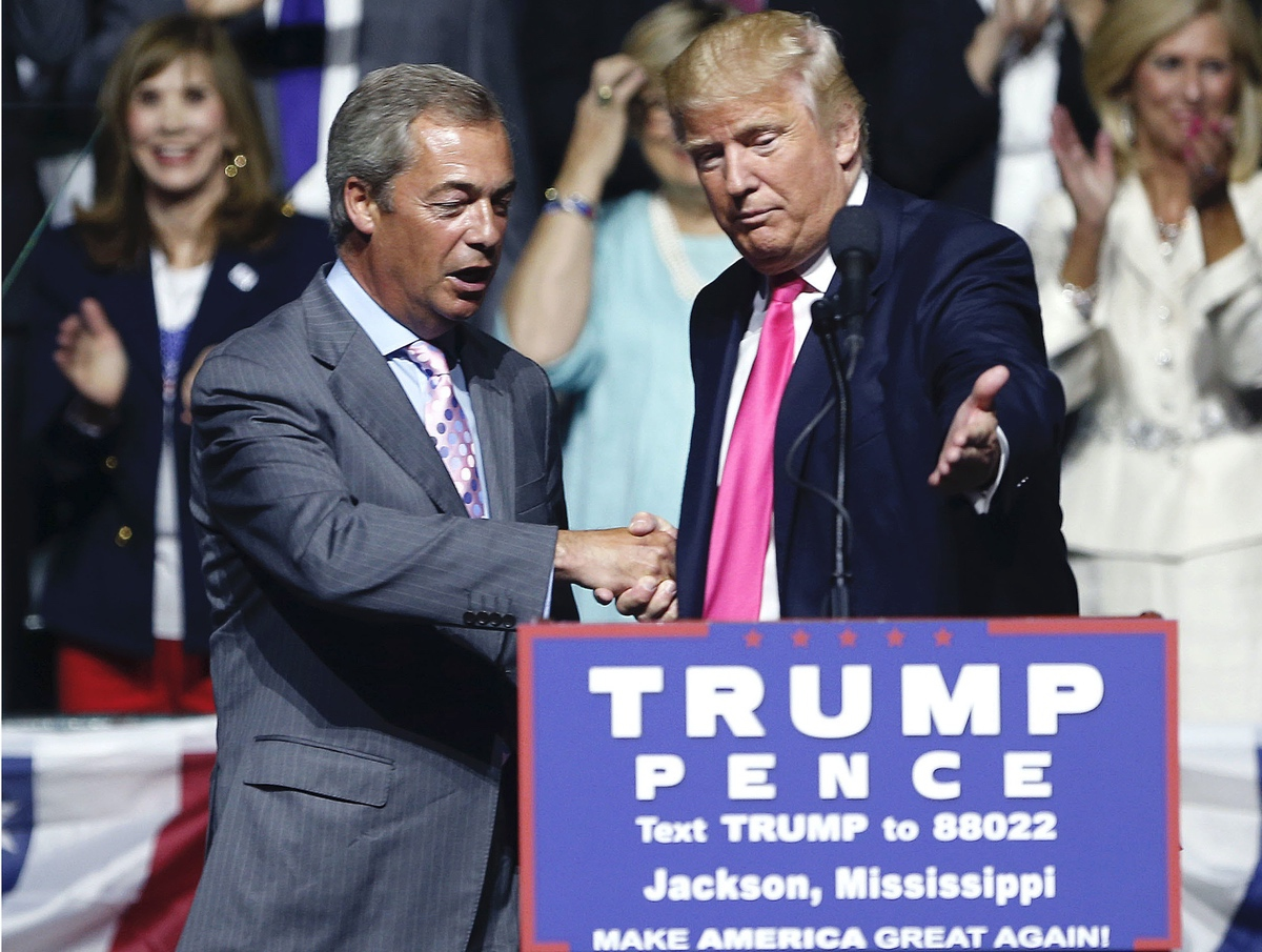 Donald Trump welcomes Nigel Farage, ex-leader of the British UKIP party, to speak at a campaign rally in Jackson, Miss., Wednesday, Aug. 24, 2016. (AP Photo/Gerald Herbert)