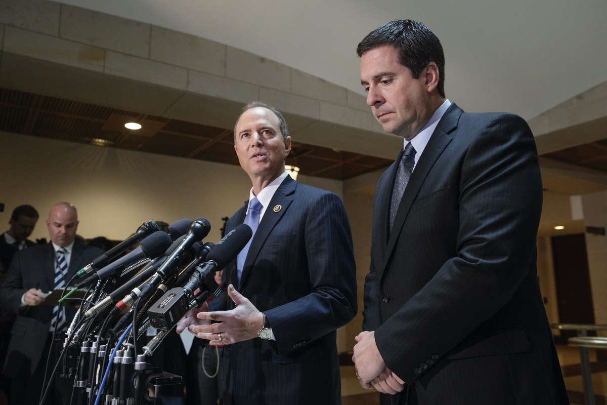 Chairman of the House Permanent Select Committee on Intelligence Rep. Adam Schiff, D-Calif., joined at the right by the ranking member Devin Nunes, R-Calif., talk to reporters about their investigation Russian influence on the American presidential election, on Capitol Hill in Washington, March 15, 2017 – Nunes was chairman at the time this photo was taken, so the caption reflects their post-midterm titles. (AP Photo/J. Scott Applewhite)