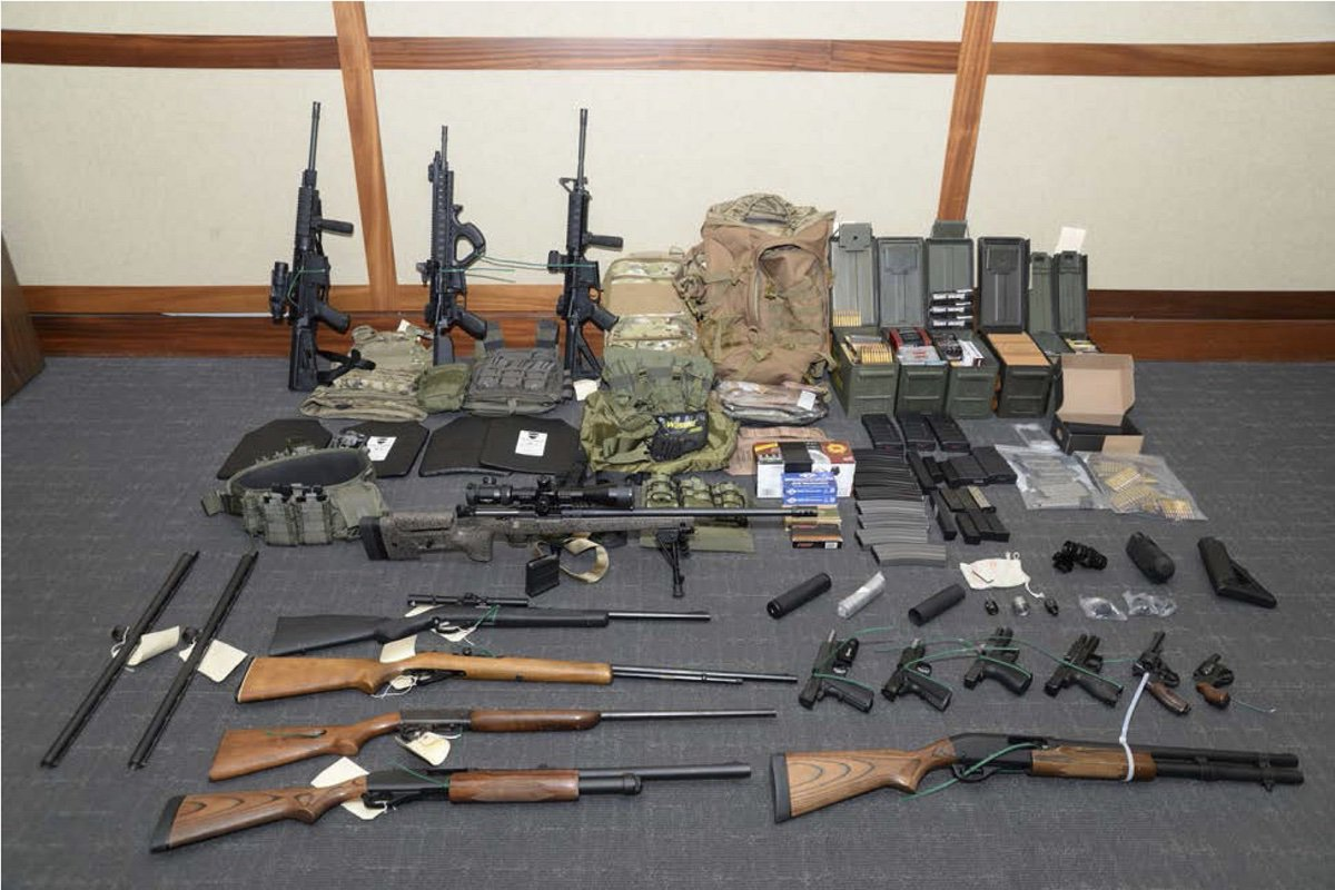 This image provided by the U.S. District Court in Maryland shows a photo of firearms and ammunition that Lt. Christopher Paul Hasson was allegedly stockpiling for his terror plot. (U.S. District Court in Maryland)