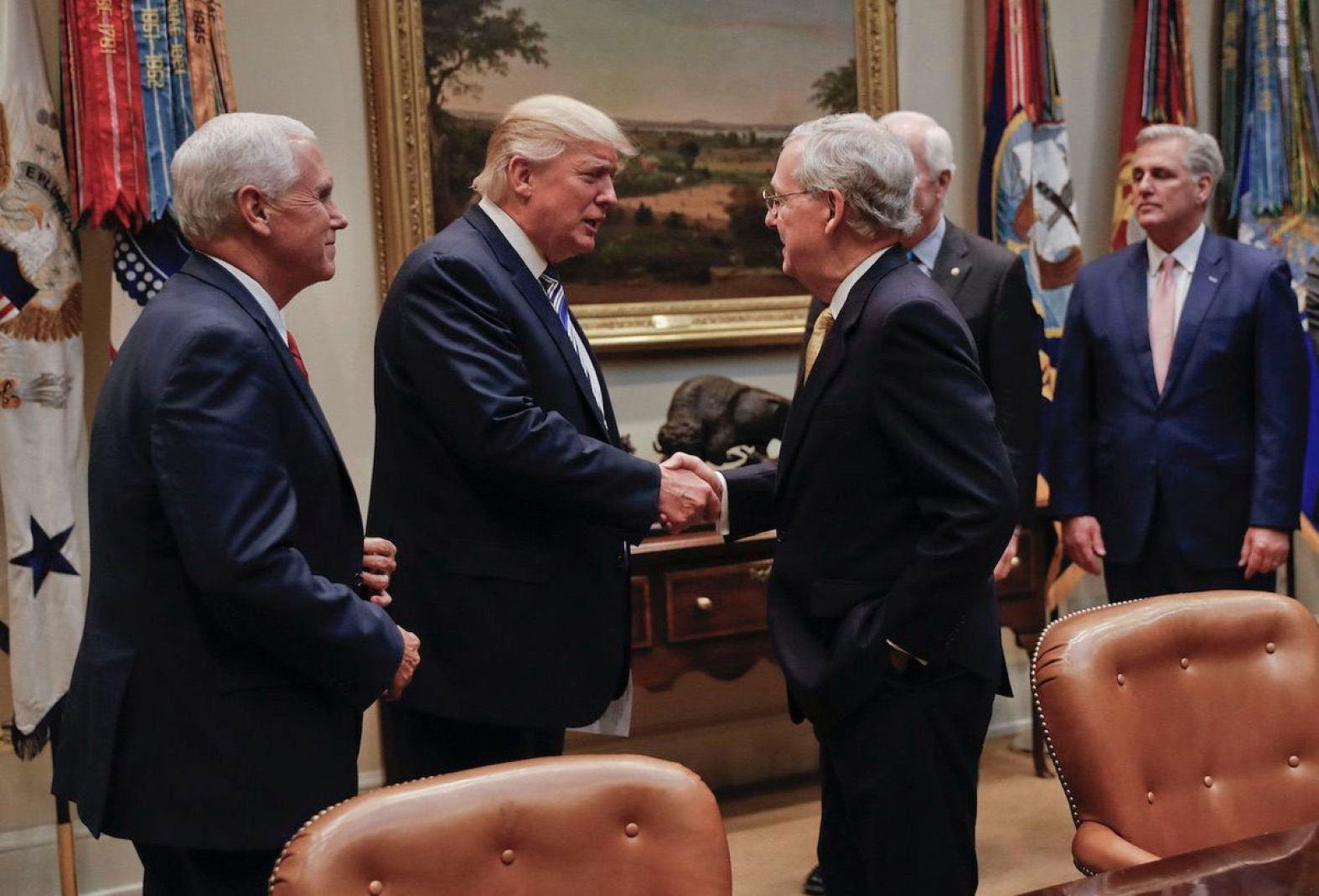 President Donald Trump shakes hands with Senate Majority Leader Mitch McConnell of Ky., center, before the start of a meeting with House and Senate Leadership in the Roosevelt Room of the White House in Washington, Tuesday, June 6, 2017. (AP Photo/Pablo Martinez Monsivais)