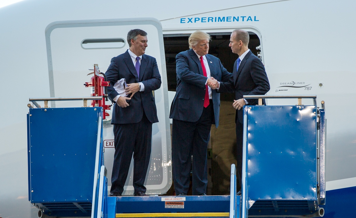 President Donald Trump shaking Boeing CEO Dennis Muilenburg's hand at the ceremony for the rollout of the Boeing's first 787-10 in South Carolina in North Charleston, SC - On February 17, 2017. (Wikimedia/Ryan Johnson)