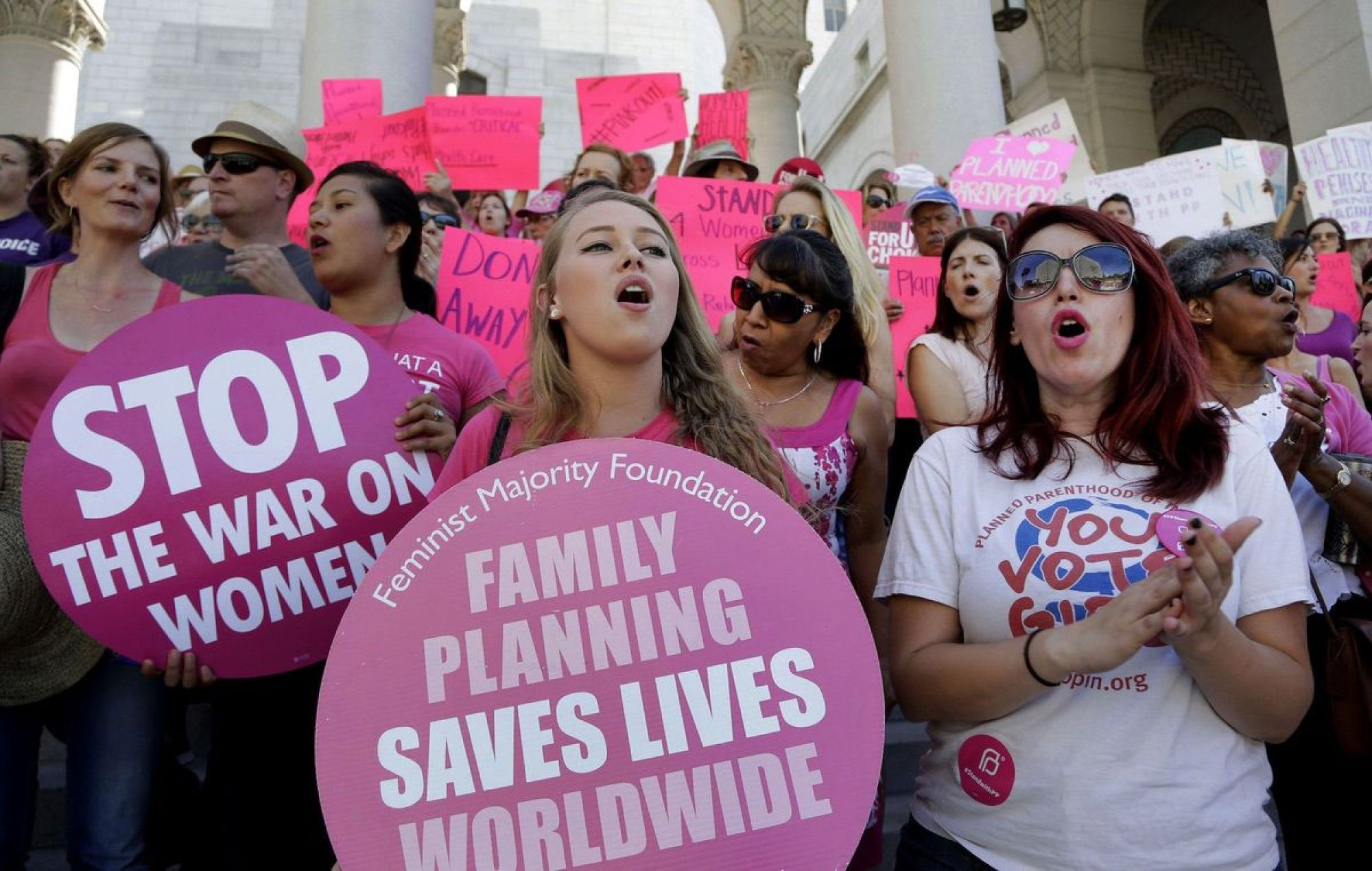 "Planned Parenthood supporters rally for women's access to reproductive health care on ""National Pink Out Day'' at Los Angeles City Hall - Sept. 9, 2015. (AP Photo/Nick Ut, File)"